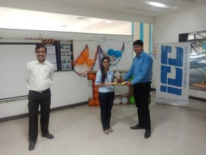 Vishal Upadhye, HR Head giving Award to employee.