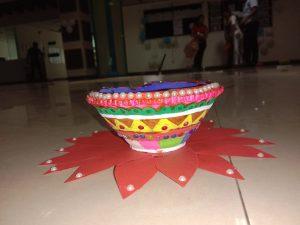 Diya decorated by employee.